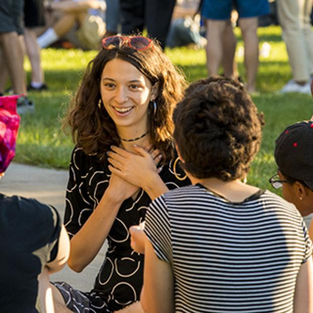 Students chat at the all campus picnic