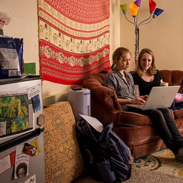 two students sit in dorm room