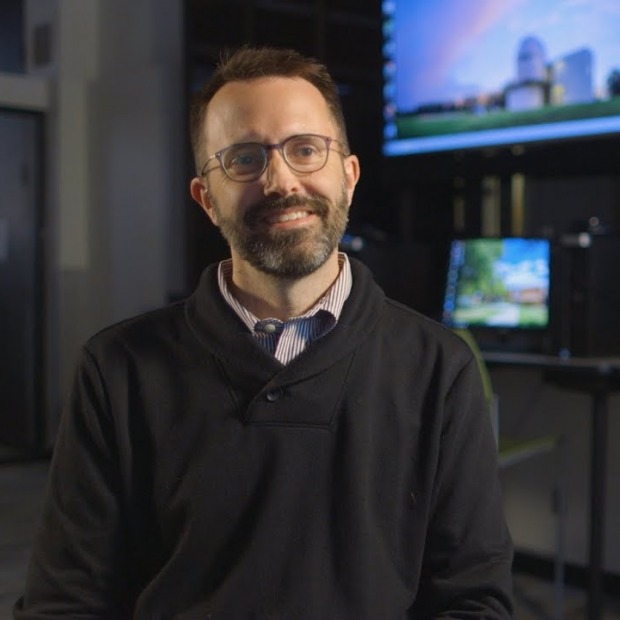 Erik Simpson in front of monitors
