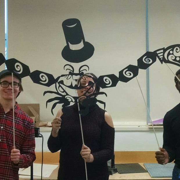 Students holding a shadow puppet