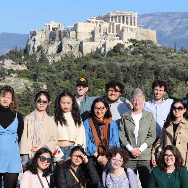 Students and Professor Monessa Cummins with the Athenian Acropolis behind them