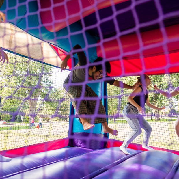 Students jump in bounce castle on south campus