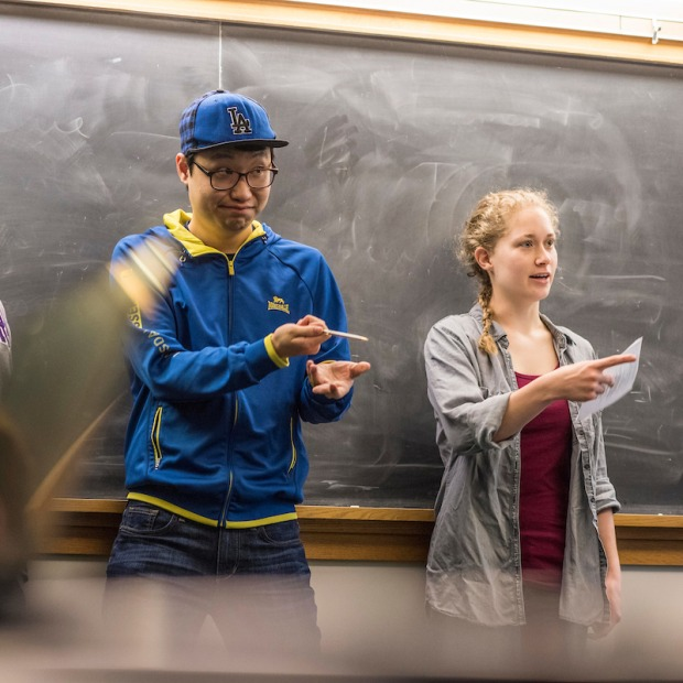 Students standing at chalkboard
