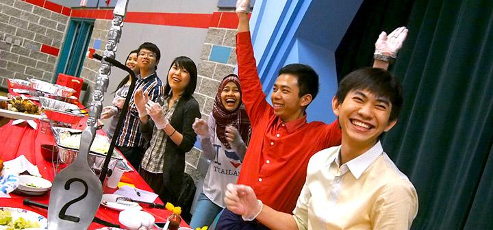 Students clap for the second place award