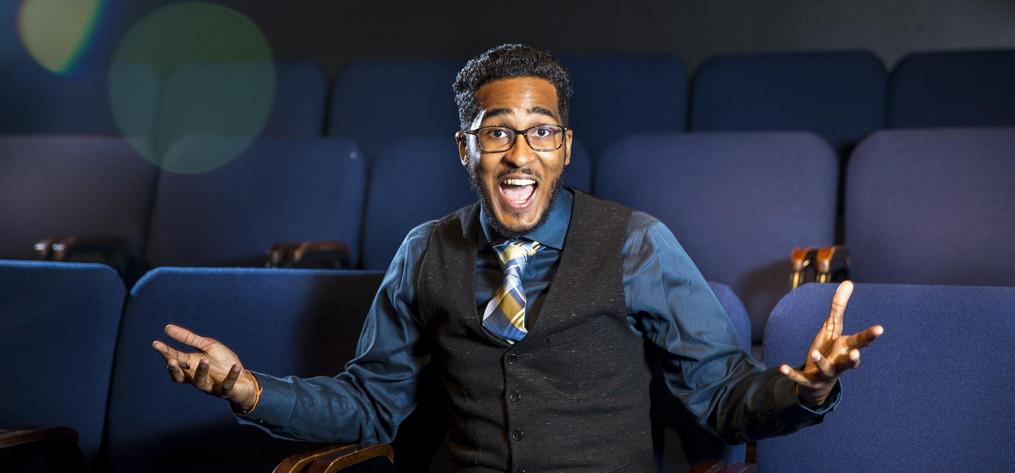 Chris Bulbulia shows his excitement from a seat in an otherwise empty theatre.