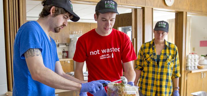 Students serve food