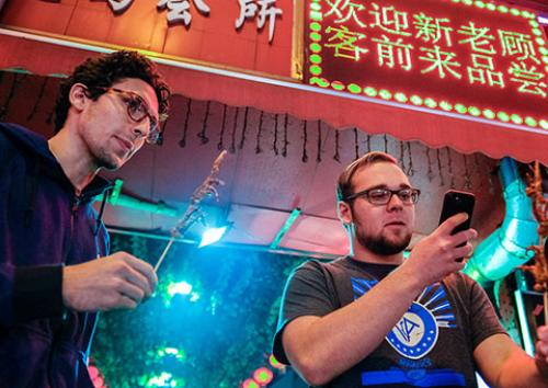 two students try exotic food in Shanghai