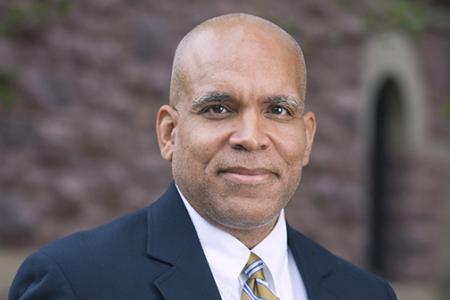 Grinnell President Raynard Kington stands in front of Goodnow Hall