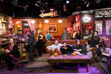 Grinnellians on the 2017 Rosenfield - CLS industry tour to Los Angeles pose on the set of Friends