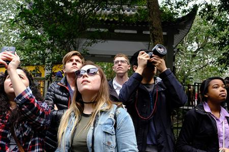 Students take photos at Lingyin Temple in China