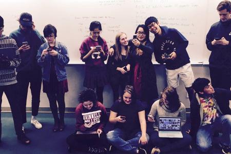 Students in the Social Media tutorial in light-hearted poses with their laptops, tablets, and phones.
