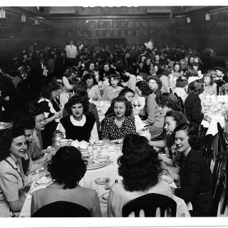 #tbt This photo was previously misidentified but just this week we learned the story behind it, thanks to Phyllis Miller Lawrence '48 and her daughter, Maggie Lawrence Banning '82. The photo is from Quad Dining Hall on Thanksgiving 1944. The government had declared that the trains were to be kept free for the war effort, so students remained at Grinnell for the holiday. Phyllis Miller Lawrence '48 is pictured on the left, wearing the black velveteen jumper with a white crepe blouse (sewn by her mother) and remembers that the students were asked to dress up for the occasion and that the food was better than normal.  #grinnellcollege #grinnellalumni #crowdsourcing #worldwarII