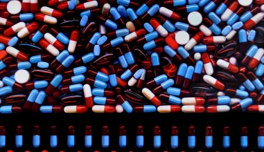 painting of pills in rows and scattered