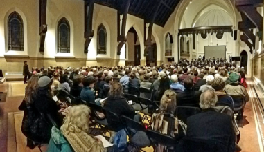 The Grinnell Singers performing with Lyra Baroque Orchestra to a full house in St. Paul