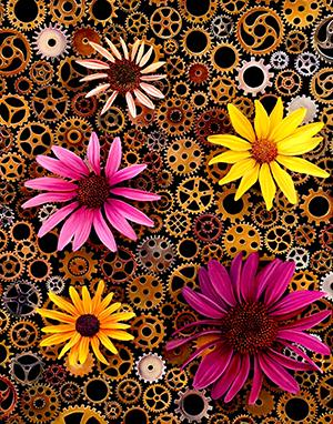 Cogs and machinery in background with brightly colored gerbera daisies