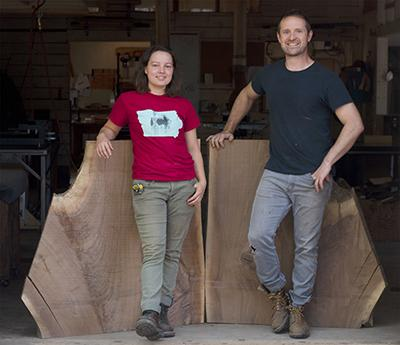 Tor and Isabella standing in front of wood slab