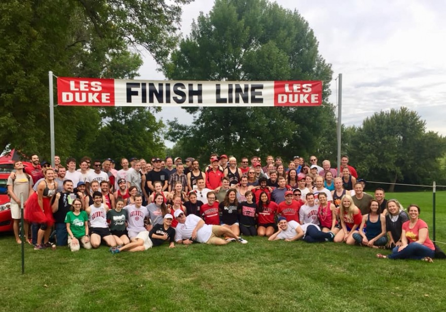 Alums and students gather at the finish line of the Les Duke invitational