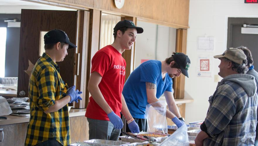 students and community members share a meal
