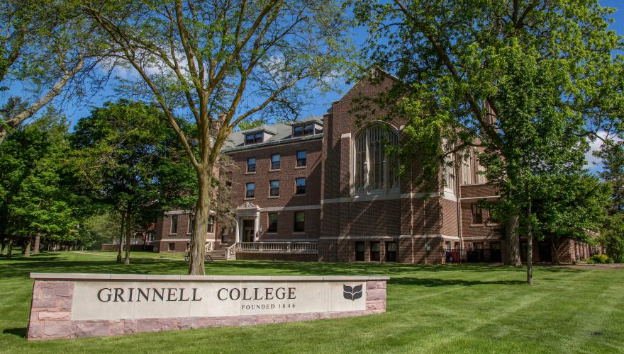 Main Hall and Grinnell College sign