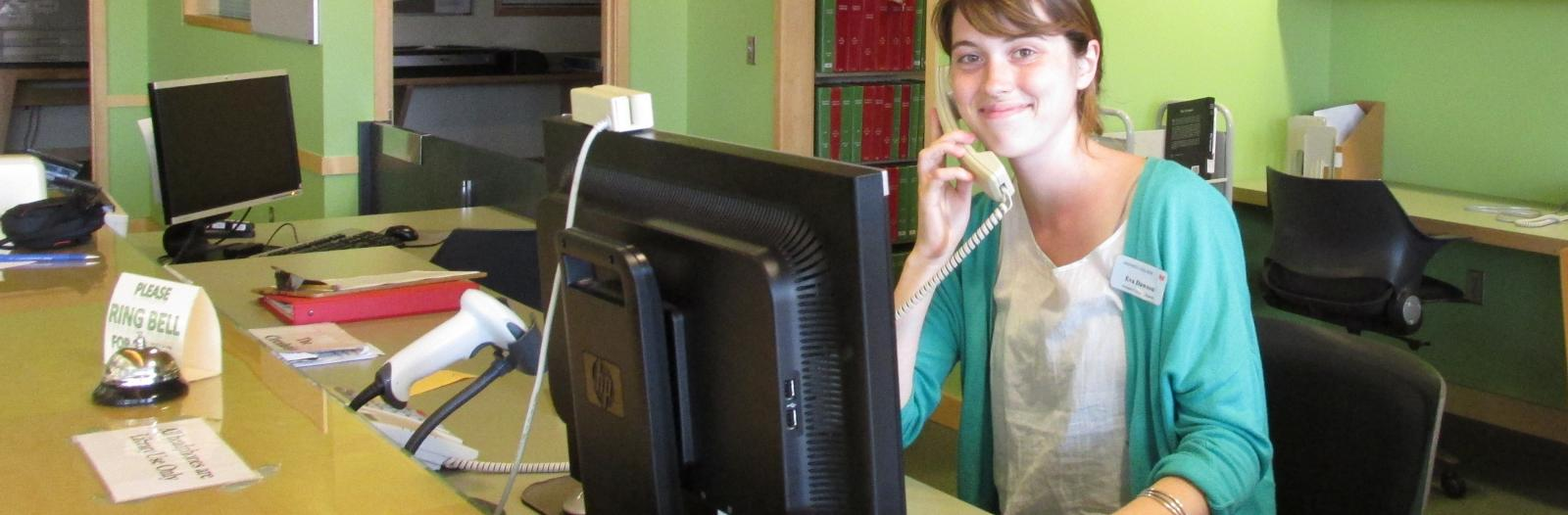 Student employee Eva Dawson staffs the circulation desk at Kistle Science Library