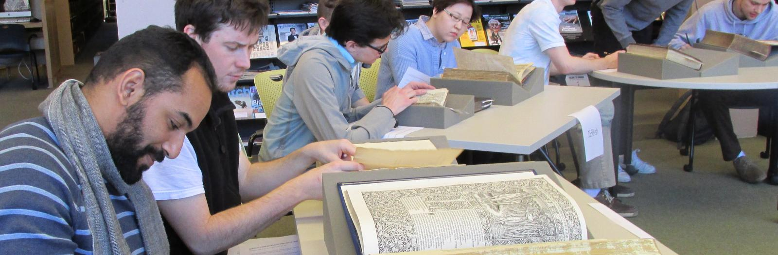 Students in the History of Technology class examine early modern books from Special Collections