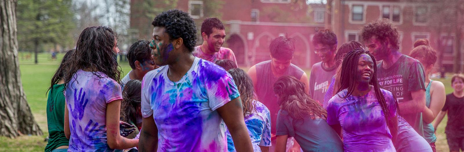 Students celebrate Holi with colored powders