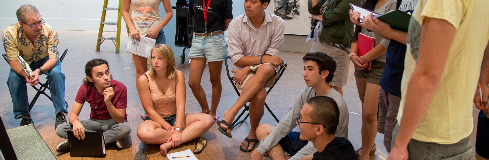 Students gather in Faulconer Gallery for a tutorial discussion