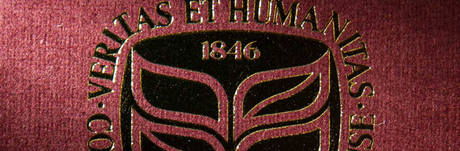 Grinnell College seal embossed in gold ink