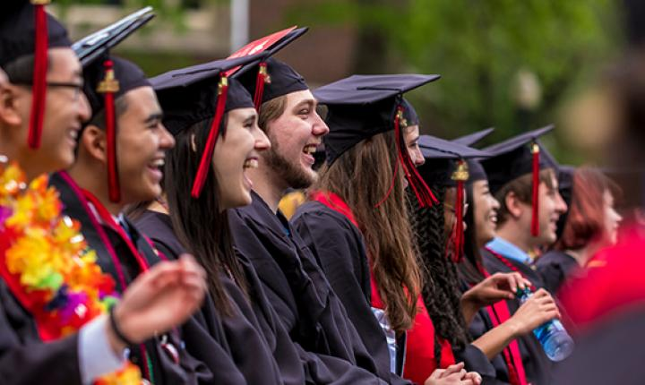 Graduates laugh during commencement ceremony