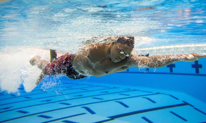 Joshua Tibatemwa swims laps as part of his training for the 50-meter freestyle.