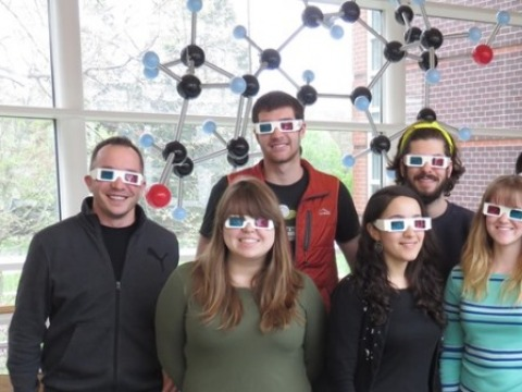 Students and their guest alum wear 3D glasses