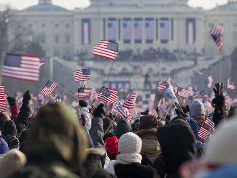 crowd with American flags at capitol