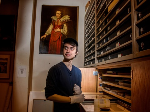 Owen Daley '20 looking at different pieces in the Print and Drawing study room in Burling Library Feb. 2019