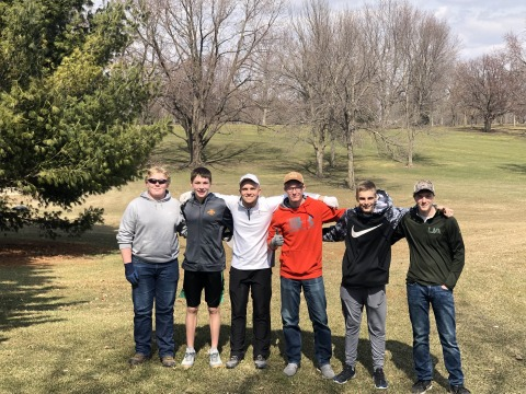 Grinnell High School boys golf team pose at golf course for cleanup