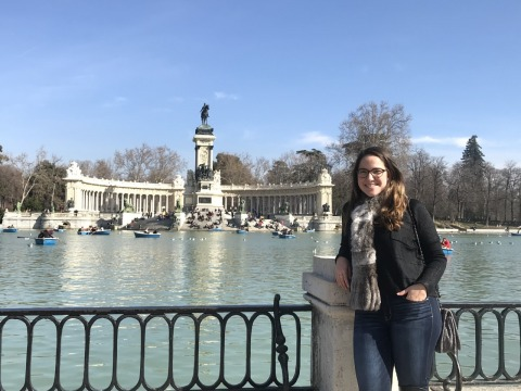 Natalie Gentil stands in front of the pond at Retiro Park in Madrid