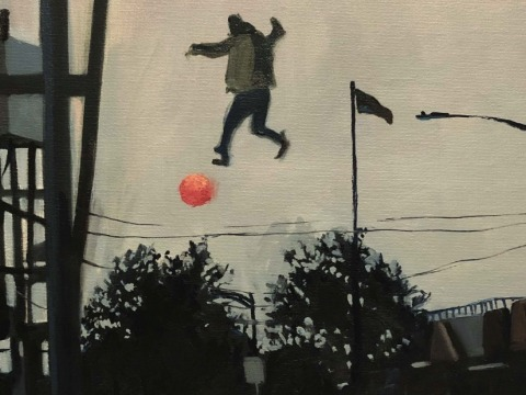 Man in air with ball
