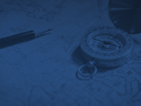 Compass and map on desk
