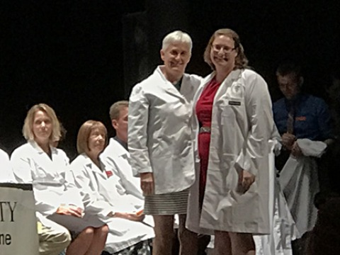 Sara Mathews '82 participates in Miranda Thomas '17's white coat ceremony