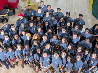 A large group of students in matching T-shirts