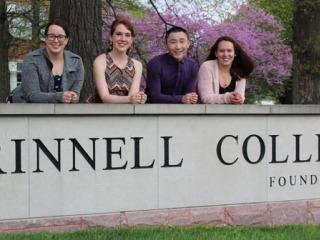 Fulbright students in front of Grinnell sign
