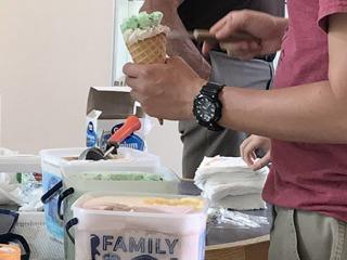 Student scooping ice cream during annual Ice Cream Social