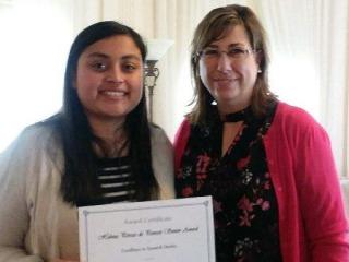 Yesenia Ayala with award