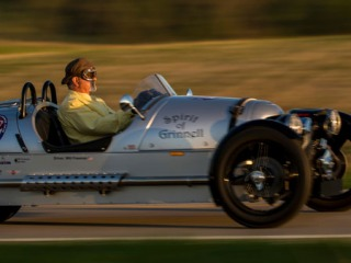 Professor Freeman driving in the 'Spirit of Grinnell'