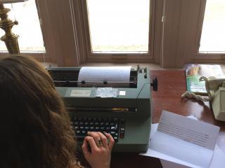 back of student at typewriter