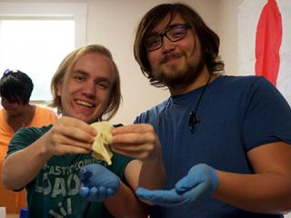 Peter Marsh '19 (left) and Jacob Shima '21 proudly display their finished mooncake.