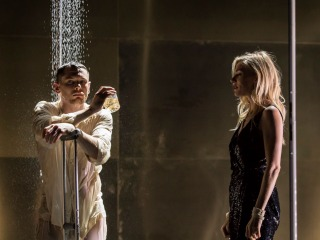 Man under shower with woman watching (scene from Cat on a Hot Tin Roof)