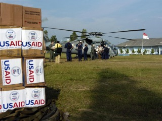 helicopter and boxes with USAID stickers