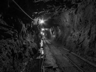 Mining tunnel with tracks