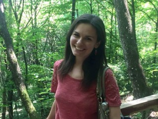 Emily Mesev in a forest