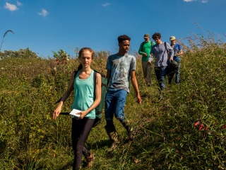 Vince Eckhart and 4 students walk through Conard Environmental Research Area